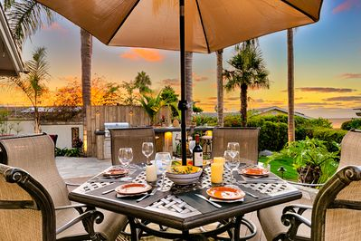 Exquisite patio for al fresco dining complete with sunset and ocean views.