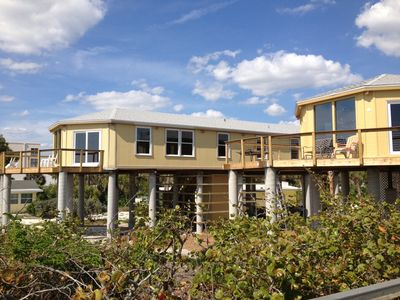 Photo for See and Hear the Waves crashing at this 3BR House on Stilts Directly on the Gulf