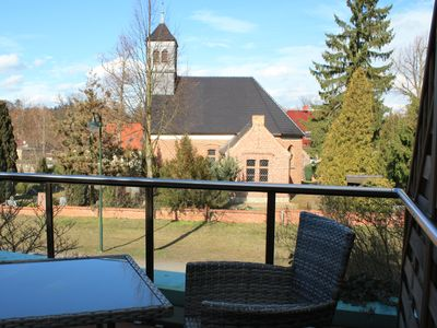 Photo for Suite with terrace overlooking church, lake access - Ferienhof Löschebrand