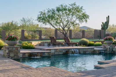 Backyard with pool/spa and putting green