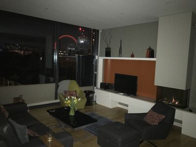 West View at night with London Eye.  Cozy fireplace warms up the living room day