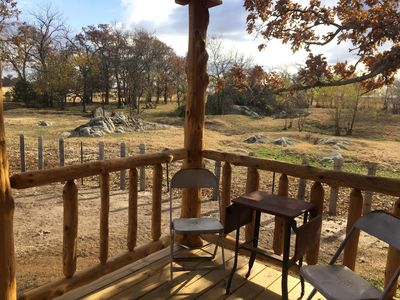 Back porch view of granite outcroppings. Pond is to the right.