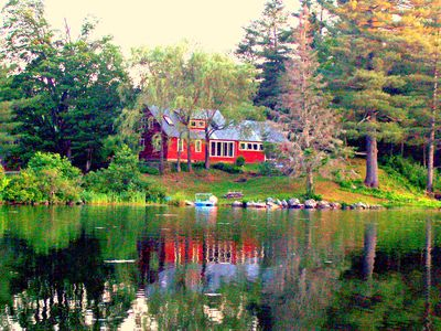 Photo for Beautifully renovated antique farmhouse on pristine lake.