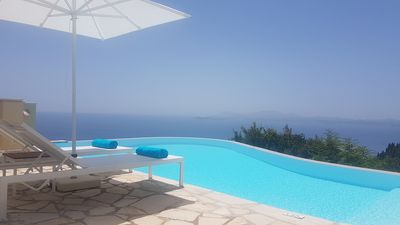 Photo for Stylish Villa with A/C, Private Infinity Pool, Spectacular Sea Views to Bay of Agni & Corfu Town!