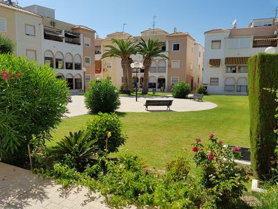 Photo for Perfectly located, refurbished apartment in a gated complex with pool and garden