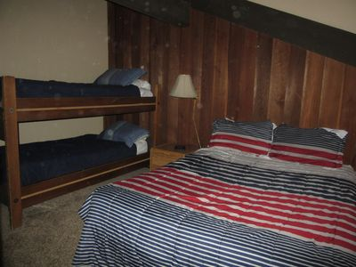 Loft with queen size bed & twin bunk bed.