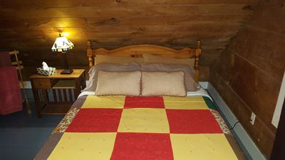 This is a Sal's Place Queen room, spacious and all natural wood. Great view of the Annapolis River, the town and the backyard of Sal's Place. Bed is a queen size and room furnished with all amenities, including a desk and HDTV.