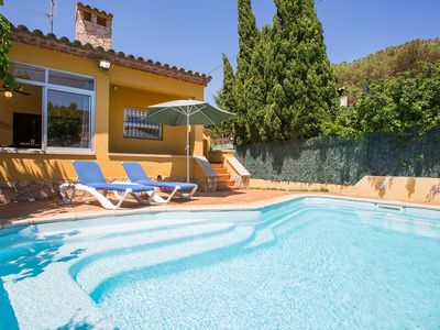 Photo for This 3-bedroom villa for up to 6 guests is located in L'Escala and has a private swimming pool and W