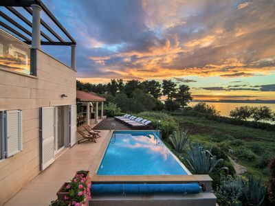 Photo for Beachfront villa with heated infinity pool, seaview terraces & eco gardens