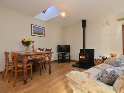 Light and airy dining/lounge area with wood burner