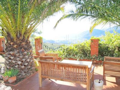 Photo for Secluded hillside villa with panoramic views and nearby beaches