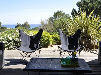 Photo for Charming waterfront villa on the beach of Palombaggia
