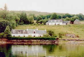 Front view of the cottages from across the Loch