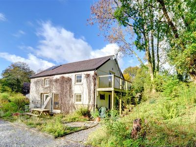 Photo for Couples staying at this contemporary watermill conversion have the benefit of 27 acres of landscaped