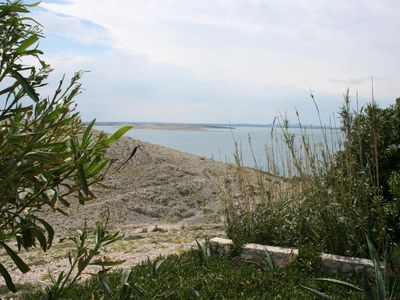 Photo for One bedroom apartment with terrace and sea view Cove Smokvica, Pag (A-6314-a)