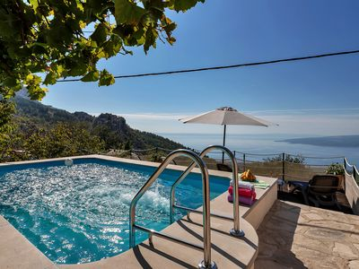 Photo for Holiday house with pool, terrace and sea view for up to 5 people