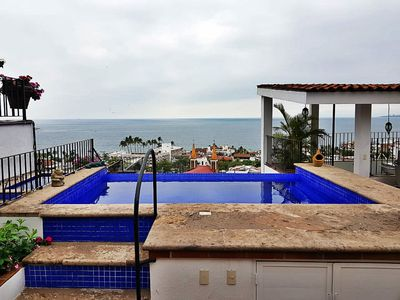 Photo for Condo, steps to BEACH w/awesome OCEAN VIEW!, INFINITY pools and BBQs