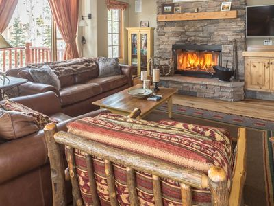 Photo for Private slope-side home with stone fireplaces, a hot tub and decks with evergreen views