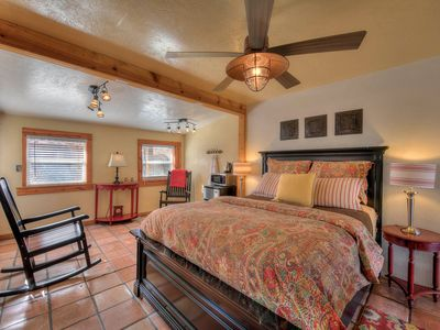 Photo for Downtown Cottage, sleeps 2. Shared yard, hot tub and lush gardens.