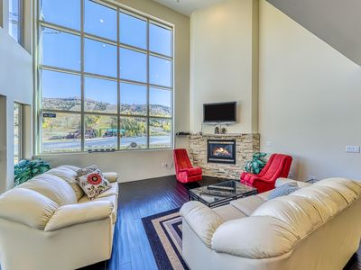 Photo for Modern & bright two-level condo w/ balcony & front row ski slope views
