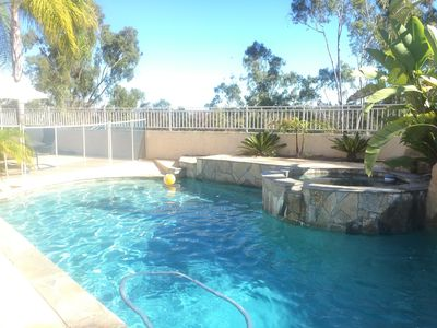 Swimming pool with shallow and deep end. Full removable fence around pool