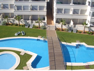 Photo for Penthouse 200m Beach with AC, Wifi, UK TV, Roof Terrace/Sea View and Resort Pool