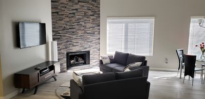 Electric flame fireplace to set and warm the living room mood.