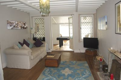 Large sitting room looking through to sunroom