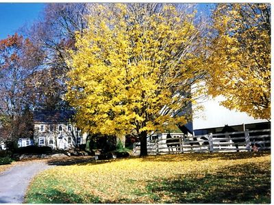 Beautiful Autumn foliage over the Stone Home and barn. Lovely quiet setting.