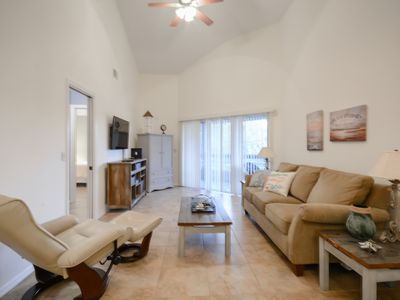 Photo for Lovely updated, open 2 bedroom 2 bath veranda. Walking distance to the beach. SV227