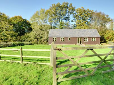 Photo for Spacious holiday home in Rolvenden offering beautiful views of surrounding fields and forests