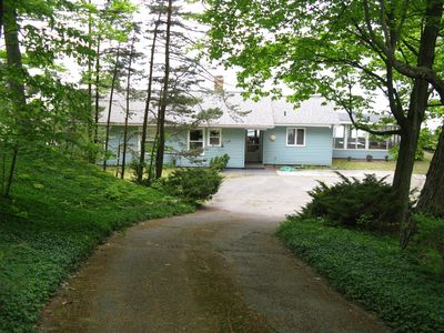 Driveway down to the cottage and parking area from the private road.
