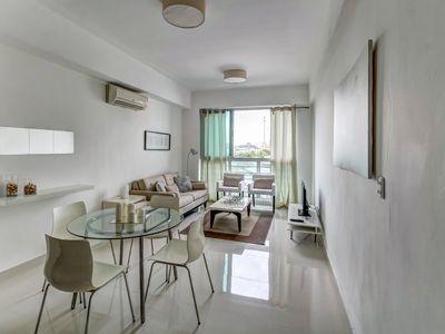 Photo for Cozy modern condo with a great location near the sights of Santo Domingo!