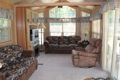 Living room area with 2 pull out couches, electric fireplace, tv, dvd player