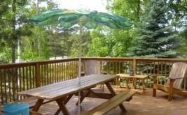 Upstairs deck with picnic table & shade umbrella to relax on those lazy summer days and nights
