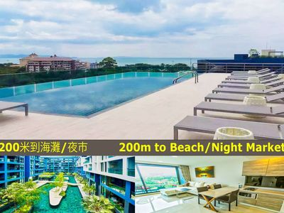 Photo for Beautiful condo with pool view next to Night Market