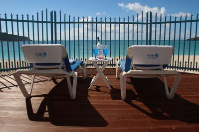 private lanai with longchairs