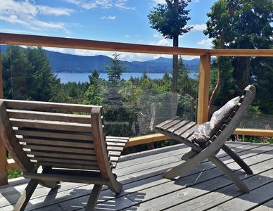 A sunny spacious deck offers a view of the ocean and across to Vancouver Island.