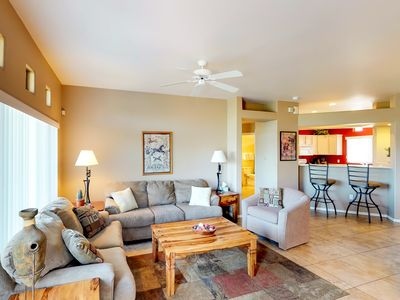 Photo for Colorful and art-filled condo with a shared pool and hot tub!