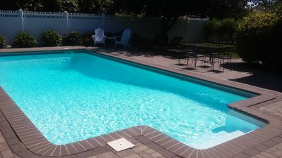 heated pool with cleaning service included in price