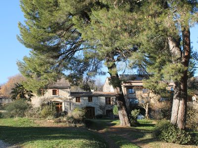 Photo for THE COTTAGE OF RURAL Bergnes, in the shade of large pine trees with pool