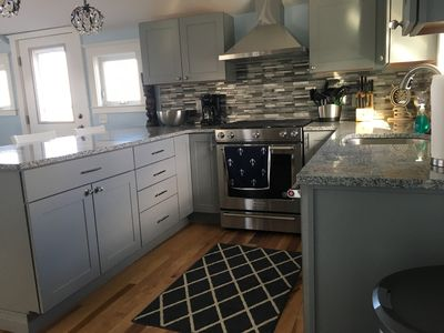 New kitchen with all new stainless steel appliances and granite countertops