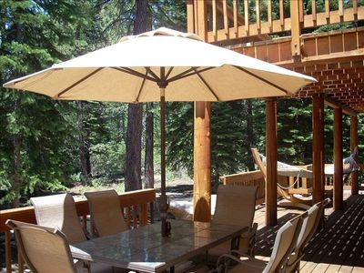 relax on the deck in the hammock and hot tub, kids can play in the clearing