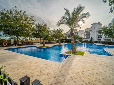 Photo for Perfectly located 2 bedroom ground floor golf course view poolside apartment