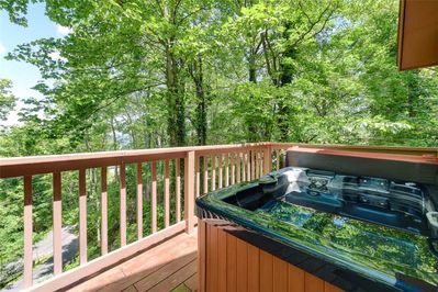 Relaxation is practically guaranteed - The deck's hot tub is a pampering spot for admiring the sun-dappled woodlands during the day and the star-studded sky at night.