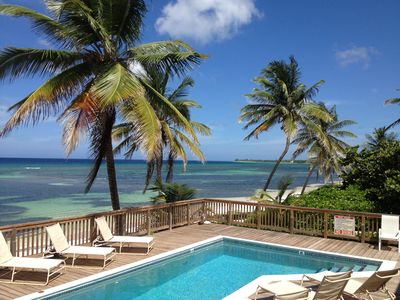 The Pink Beach House boasts an expansive deck and pool directly on the Caribbean