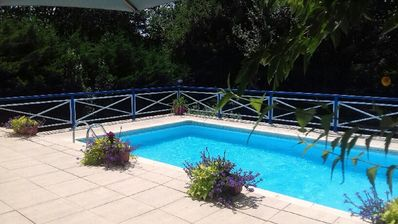 Photo for Tasteful spacious1bed appartment with patio and balcony overlooking private pool