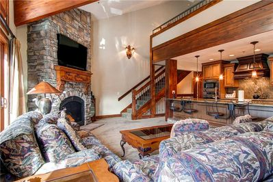 Spacious living room large screen TV indulgent fireplace open kitchen dining - Park City Lodging-Little Belle 15