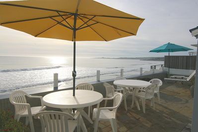 Oceanfront Patio with 2 dining tables, lounges and fire pit