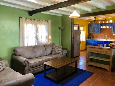 Living room w/ fold out couch, TV and electric fireplace